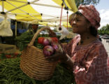 At the Cherry Creek farmer's market Betty fills her basket with fresh vegetbles for her recipies....