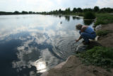 DLM043  Diana Kollath, 46, of Denver rinses her hands in the waters of Rocky Mountain Lake,...