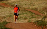 (GOLDEN  Colo., May 5, 2004 )  Denice Murphy, of Morrison, runs along the dirt  trails at Mathews...