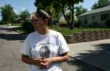 Priscilla Arzate, cq, the mother of slain young man Ronnie Hernandez stands in the street of of...