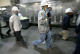 Employees march toward the break area at the Swift and Company Greeley beef plant in Greeley,...