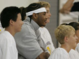 JPM0005 Denver Nuggets forward Carmelo Anthony poses for photos with unidentified  basket camp...