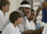 JPM0009 Denver Nuggets forward Carmelo Anthony poses for photos with unidentified  basket camp...