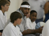 JPM0011 Denver Nuggets forward Carmelo Anthony poses for photos with unidentified  basket camp...