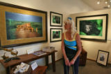 Nancy Bassi (cq), from Adams Mass., looks at photos at the Images of Nature gallery in the main...