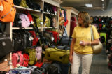 Jean Summer (cq), of Phoenix Arizona, looks at luggage in the Airport Baggage Center in the main...