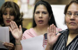 (L-R) Norma Cabal(cq), Florita Villagrana(cq), and Angelina Miranda(cq) take their oath to the...