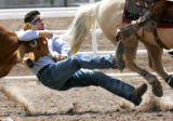Alexander Robertson wrestles a steer in 11.5 sec. during the 2006 Cheyenne Frontier Days...