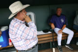 MJM2406  Tracy Ringolsby (cq), left, talks to Colorado Rockies manager, Clint Hurdle, right,...