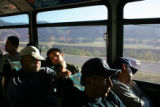 Workers nap on a Roaring Fork Transit Agency bus taking them to jobs in Aspen from Carbondale on...