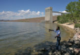 William Foster (cq), of Aurora, does some fishing near the Cherry Creek Dam July 12, 2006 in the...