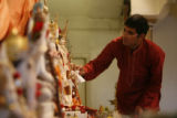 DLM396  Ravi Krishnaswamy, 29, of Centennial prepares for the evening services at the Hindu Temple...