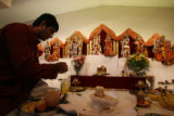DLM367  Ravi Krishnaswamy, 29, of Centennial prepares for the evening services at the Hindu Temple...
