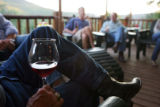Bob Cudd (cq, left holding wine glass) of Taos, N.M. sits on the deck at Smith Fork Ranch in...