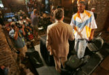 Carmelo Anthony, right, shakes the had of Denver Nugget's owner Stan Kroenke, left, to thank...