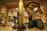 Concerned father Craig Mast, CQ, 42, of Warren Ohio, inspects his son Craig Mast Jr.'s, wheel...