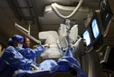 Dr. John Altman(cq), second from left, an interventional cardiologist, watches the screens and...