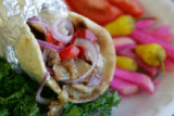 A chicken Tarna Wrap, a specialty at California Bakery, a bakery and restaurant in an ethnic...