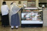 Customers shop at California Bakery, a bakery and restaurant in an ethnic shopping center at...