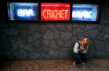 Amy Jeen Hill (cq) lights up outside of the Cricket on the Hill on 13th Ave in Capitol Hill.  As a...