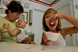 Lynn Wilson (cq), left, of Denver sits in the air conditioned ice cream parlor with her...