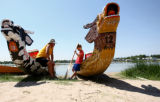 Heath Miiler, left, of Vincent, Iowa, talks about the dragon boats with Jared McMaster, 7, of...