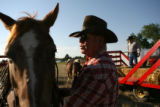 Chuck Bailey(cq), of Pagosa Springs, Co., talks to his horse Roney before heading out to help in...