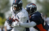 Broncos wide-receiver Rod Smith (#80), left, gets pressured by center-back Champ Bailey at Broncos...
