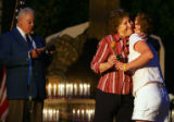 Marlene Johnson (cq), center right, of Highlands Ranch, hugs Tina Anderson-Seaman (cq), right,...