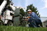 Xcel Energy lineman Brenda Lott, cq, preps the contacts for a new transformer Monday July 17, 2006...