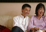 KAS071 Joshua Zhong, left, and Lily Nie laugh during an interview in their Centennial home on...