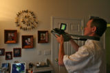 Steve Byers (cq) uses a infrared camera during his energy efficient house testing for the...