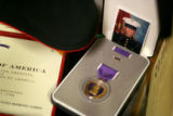 Photos, medals, patches and other reminders of Marine SSG Sam Holder are kept in his room in his...