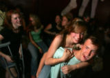 Arianna Hill (cq), 15, center right, and Ryan Saunders (cq), 15, right, dance to the punk band the...