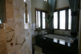 "The onyx bathroom of ""The Circle of Life,"" designed by Knudson Gloss Architects and..."