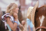 KAS155 Natalie Boldt (cq), 13, left, hangs her hat on her brother's horse during the junior rodeo...