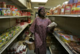 Rocky Mountain News business reporter Betty Abah from Nigeria shops at Lagos Market in Aurora...