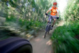 M.O. Alford (cq), 35, of Nederland flies down a trail named Aspen Alley in the West Magnolia Trail...