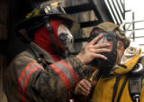 (DENVER, Colo., June 15, 2004)  Denver firefighter Capt. Eric Tate helps R.D. Seawall of Denver's...