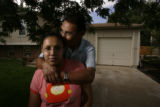 Victoria Hernandez, CQ, 14,  is held by her father Samuel Hernandez, CQ, 48, in the families front...