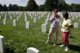 Jo Burns, cq, Laramie, Wyo., and Mary Holder, cq, Littleton, talk near the graves of their sons at...