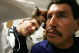 Don Gutstadt, PA-C, CQ, left, cares for Horacio Salazar, 34, CQ, at the Salud Family Health Center...