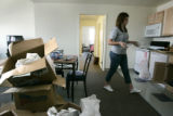 On August 1, 2006 in Denver, Colo. sophomore at UCD, Carly Helm, (cq)18 unpacks her belongings in...