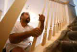 Spotlight Sub-contractor Marco Velazquez(cq), instals a custom-built hand railing in the basement...