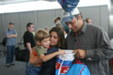 Tom and Rudy Hawat greet their five-year-old son Elijah as he rifles through a bag looking for...