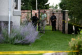Aurora Police walk through the backyard of a home at 14701 E. Purdue Place, Friday,  July 21, 2006...