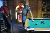 John Mlakar, cq, left, watches as Pat Howerter, cq, right, lines up a shot while shooting pool at...