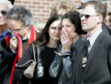 Natalie Jensen, (second from right) widow of slain officer Jared Jensen, cries as she watches the ...