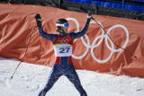 U.S. skiier Steven Nyman of Orem, Utah acknowledges the cheers of the crowd after finishing 19th...