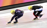 U.S. Short Track speed skater Alex Izykowski (#251) is chased by France's Jean Charles Mattei...